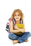 Smiling school girl with rucksack holding books Stock Photos