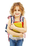 Smiling school girl with rucksack holding books Stock Image