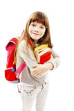 Smiling school girl with rucksack holding books Royalty Free Stock Photos