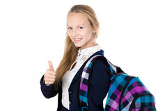 Smiling school girl showing thumbs up Stock Images