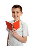 Smiling school student holding small book Royalty Free Stock Photos