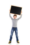 Smiling schoolboy with balckboard Royalty Free Stock Photos