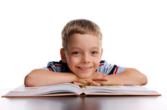 Smiling schoolboy with book. On the white Stock Photo