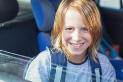 Smiling Schoolboy in the Car Stock Images