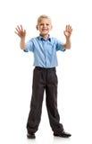 Smiling schoolboy gesturing Stock Images
