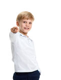 Smiling schoolboy pointing Royalty Free Stock Photography