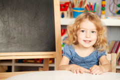 Smiling schoolchild in a class Stock Image