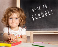 Smiling schoolchild in a class Stock Photography