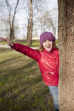 Smiling schoold age girl is in the park Stock Image
