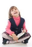 Smiling schoolgirl with book Royalty Free Stock Photo