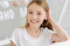 Smiling schoolgirl in casual posing for camera Stock Photo
