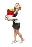 Smiling schoolgirl with christmas gifts over white Stock Image
