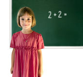 Smiling a schoolgirl in a classroom Royalty Free Stock Photography