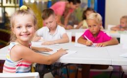 Smiling schoolgirl in elementary school age in class. Indoors Royalty Free Stock Photo
