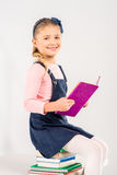 Smiling schoolgirl holding book Royalty Free Stock Photos