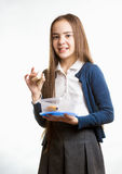 Smiling schoolgirl holding sandwich against white background Royalty Free Stock Photos