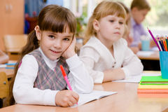 Smiling schoolgirl looking at camera during lesson Stock Image