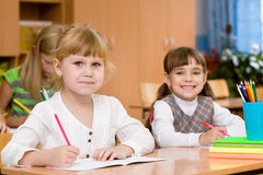 Smiling schoolgirl looking at camera during lesson Stock Images