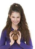 Smiling schoolgirl with pine cones Stock Image
