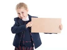 Smiling schoolgirl showing empty paperboard in hands, isolated white background Royalty Free Stock Image