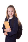 Smiling schoolgirl in uniform and with bag Royalty Free Stock Photo