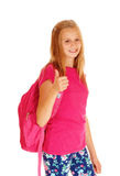 Smiling Schoolgirl With Her Thumps Up. Stock Photo