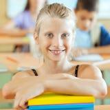 Smiling SchoolgirlPortrait of a smiling schoolgirl sitting the c Stock Images