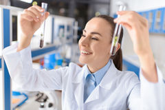 Smiling scientist holding laboratory tubes with plants Royalty Free Stock Images