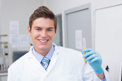 Smiling scientist holding test tube with corn inside Royalty Free Stock Photo