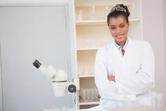 Smiling scientist looking at camera arms crossed Royalty Free Stock Image