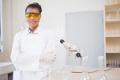 Smiling scientist looking at camera and holding clipboard Stock Photos