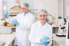 Smiling scientist looking at camera. In laboratory Stock Photos