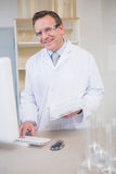 Smiling scientist using computer. In the laboratory Royalty Free Stock Images