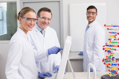 Smiling scientist working with computer Royalty Free Stock Photo