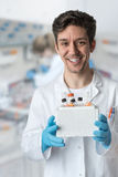 Smiling scientist works in laboratory Stock Photos