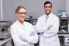 Smiling scientists looking at camera arms crossed Stock Photos