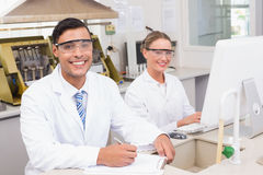 Smiling scientists looking at camera. In laboratory Royalty Free Stock Photography