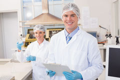 Smiling scientists looking at camera. In laboratory Royalty Free Stock Images