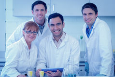 Smiling scientists with tablet PC in the lab Royalty Free Stock Image
