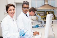 Smiling scientists working together. In the laboratory Stock Photos