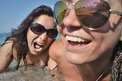 Smiling Screaming Female faces Sea Sunglasses Royalty Free Stock Image