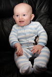 Smiling Seated Baby royalty free stock image