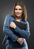 Smiling secretary with black paper folder Royalty Free Stock Image