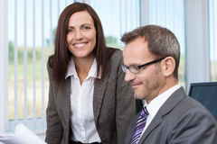Smiling secretary with her boss stock photos