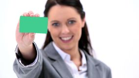 Smiling secretary holding a business card Royalty Free Stock Image