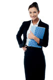 Smiling secretary holding spiral notebook Stock Photography