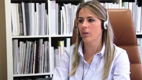 Smiling secretary receiving calls in business company stock video