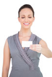 Smiling seductive model holding business card Royalty Free Stock Images