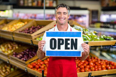 Smiling seller holding sign Stock Photos