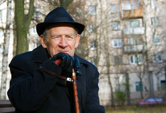 Smiling Senior. Portrait of a smiling old man in a hat and with walkingstick Stock Photography